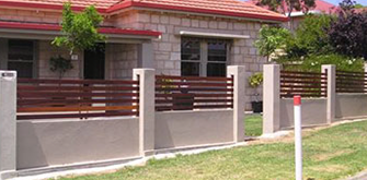 foamfast pillared fence with timber look slat insets