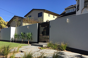rendered foamfast wall with concrete retaining wall & powder coated vertical slat gate